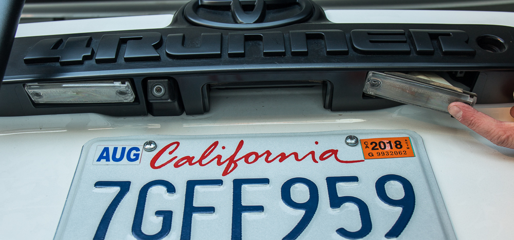 4Runner License Plate Install Step #2 -Gently Tap Housing Loose