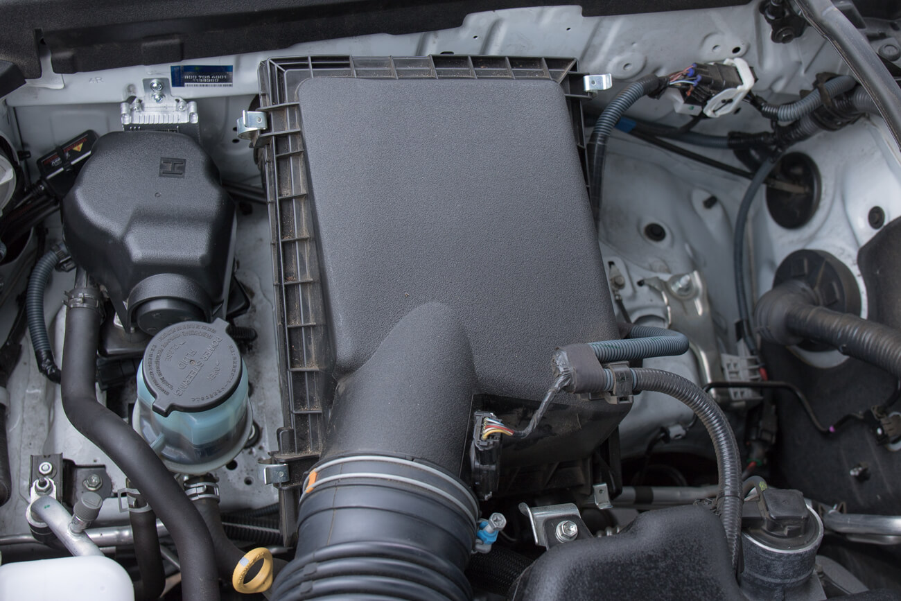 5th Gen Air Filter Replacement Step #1 - Unhook OEM air box brackets x4