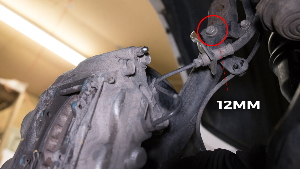 Remove 12mm Bolts on Brake Line Bracket