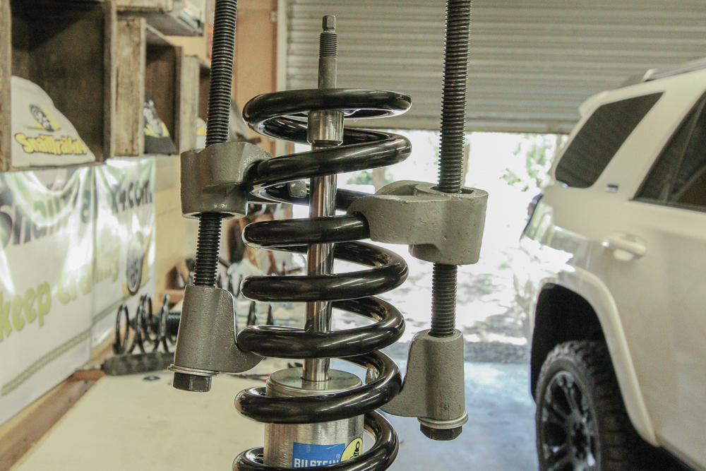 Step 10: Set Bilstein Strut in Vice and Compress Springs