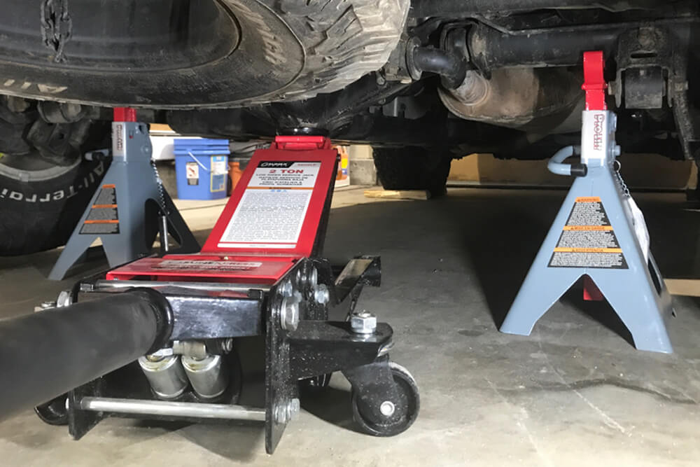 Place Blocks Under Tires - RCI Lower Link Skid Plate Install