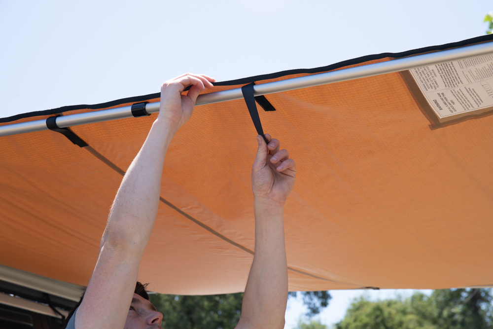 Step 7: Loop velcro straps around the rafter arms