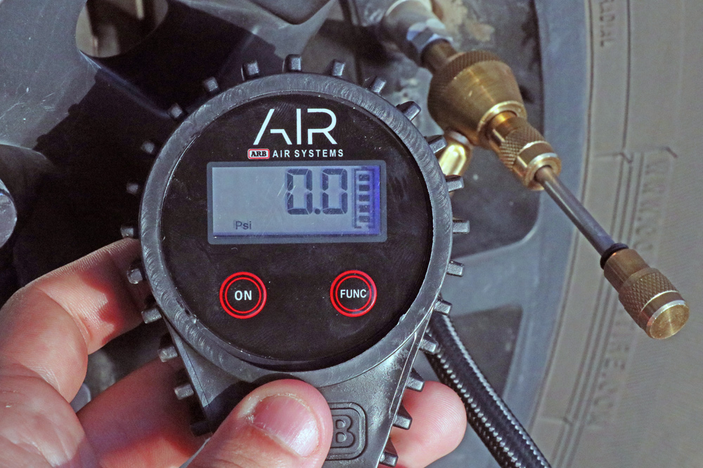 ARB Digital Tire Deflator For Lower Air Pressure For Off-Roading & Trailing in the 5th Gen 4Runner: Step 6. Push Remover into Valve Stem At Ideal Pressure