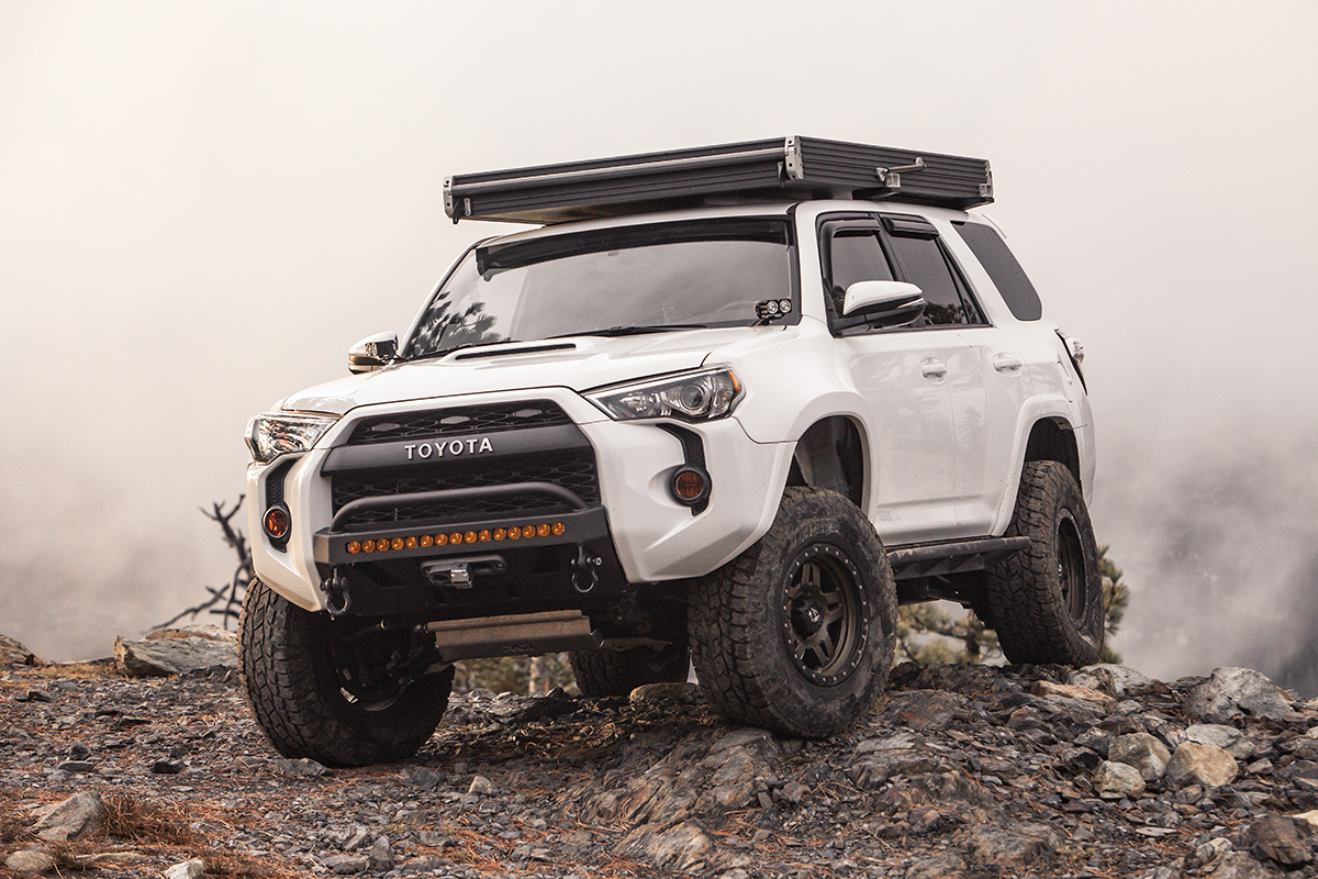 White Lifted 4Runner with Rooftop Tent & Fiberglass Fenders