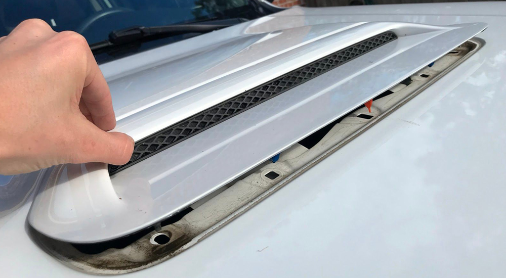 "Blacked-Out Hood Scoop Step-By-Step DIY Install For the 5th Gen 4Runner: Step-By-Step Install: Step 4. Pull Out ""Faux Grille Insert"""