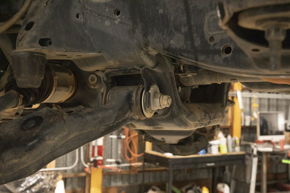 Remove Cam Tab Bolts Lower Control Arms