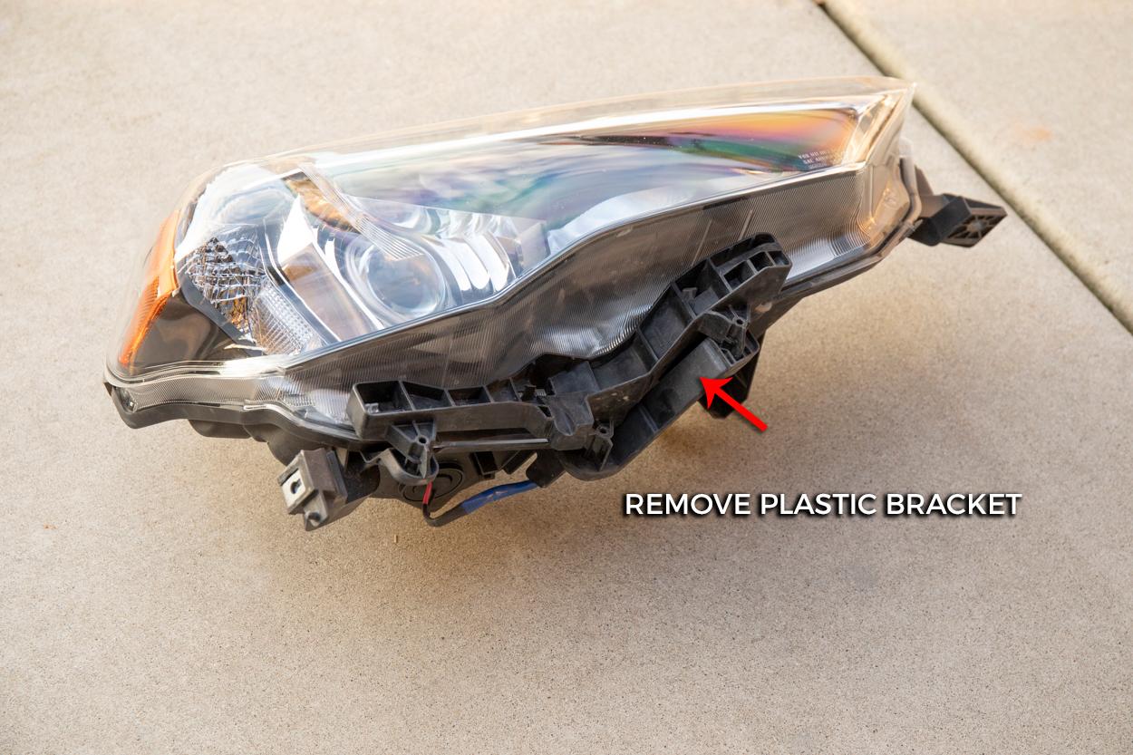 Remove Headlight Housing Bracket from Factory Headlight