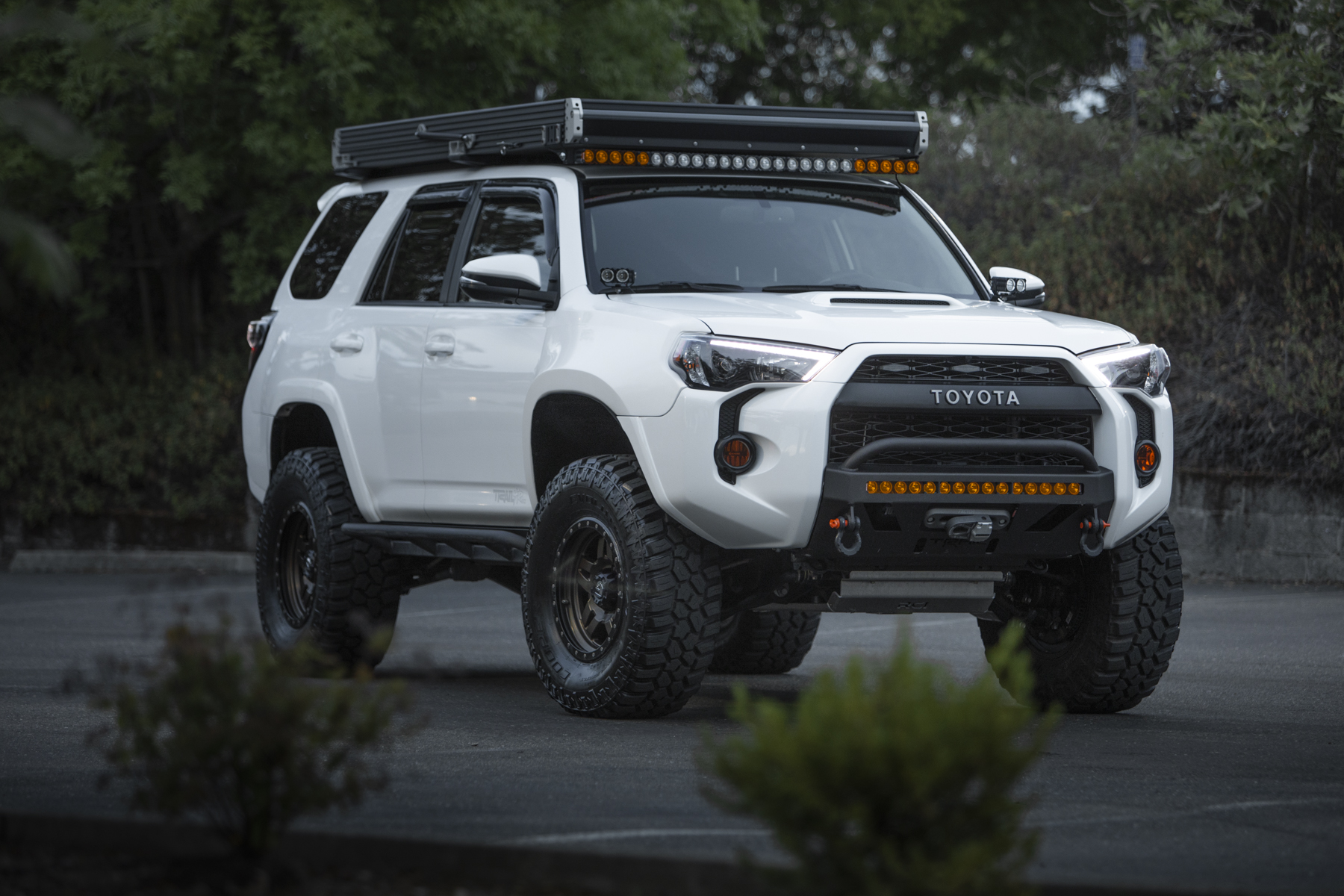 Toyota 4Runner with Go Fast Camper RTT and Lo Pro Bumper (White on Bronze)